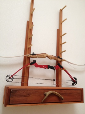 Archery rack, drawer for arrows. It has since had a few swords added.