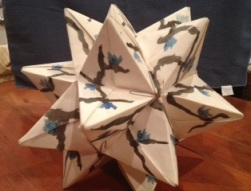 He went through an origami phase when he was little. This object is about the size of a soccer ball.