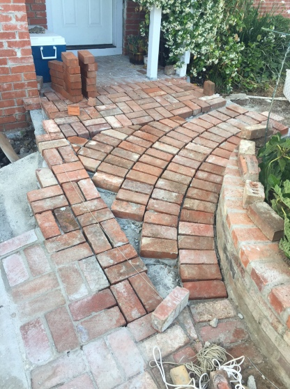 front walk in progress - the fun part: actually laying bricks!