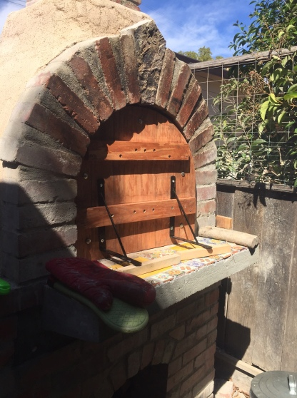 Pizza oven, front, with it's oak door